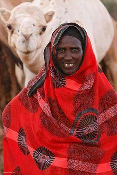 Africa   Gabera tribeswomen with camels, Kalacha, Chalbi desert, Kenya    © Paul and Paveena McKenzie