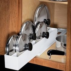 Lid Organizer  @ Fresh Finds. We need this so it's not such a chore to take out a pan!