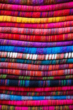 Colourful yak wool blankets for sale in the narrow streets of Thamel, Nepal. By Kimberley Coole.