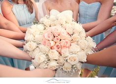 The Bride's Bouquet in the center surrounded by all of the Bridesmaids' Bouquets. :: Turner Creative Photography