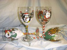 Hand Painted Christmas Wine Glasses (Sold in Pairs). A Santa, A Penguin, A Snowman and a Reindeer make the perfect holiday set! $35 Via Etsy.