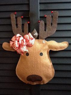 Reindeer Burlap Door Hanger. $25.00, via Etsy.  Could do with brown paper bags - glue around edges