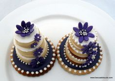 Cookie stack cakes. Purple, white, black, and brown.