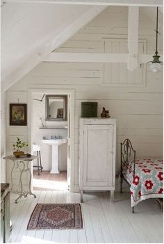 White shiplap in this rustic farmhouse room with country decor and red accents. The Best of shabby chic in 2017.
