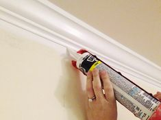 tip from younghouselove: when painting wood trim, paneling or crown - look for dark cracks after one or two coats of primer (you won't be able to see them before you apply anything, since they only pop out at you as the wood gets lighter) and then fill 'em with paintable caulk (like paintable Dap window & door caulk in white).
