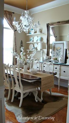 Updated country dining room. Love chandelier and shelves on wall