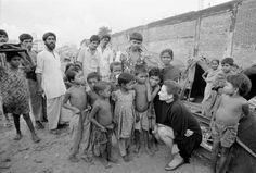 UNICEF Goodwill Ambassador Audrey Hepburn visits a group of children in a squatter settlement beside a railway track in the capital Dhaka, Bangladesh. October 18-24 (1989) Photographer- Isaac