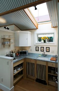 Love a sky light above kitchen sink idea.  I like lots of light in the kitchen.  What better than natural light.