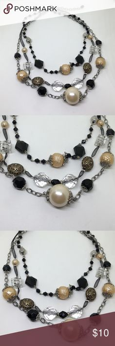 """🆕Funky Chunky Triple Strand Mixed Media Necklace A triple strand necklace that hits all of the current trends! Put faux pearls, a mix of black, clear and burnished gold beads, and a black ribbon strand together, and you have this great necklace! Adjustable up to 21"""". In like new condition; appears to have never been worn. From an Estate collection. Jewelry Necklaces"""