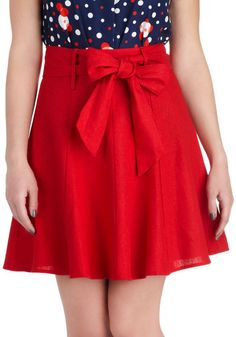 I love everything about this skirt! The color, the flare, the length, and the bow. And I don't even like bows!!!