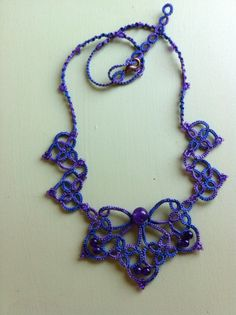 Tatted Necklace in Hand Dyed thread by rubeania on Etsy ****I like the small motifs on either side of the focal****