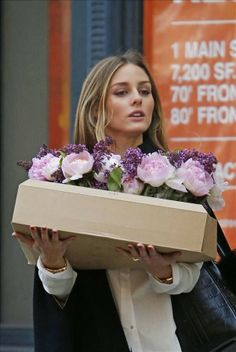 The Olivia Palermo Lookbook : Olivia Palermo wears ripped jeans while carrying a box of flowers in Brooklyn, New York