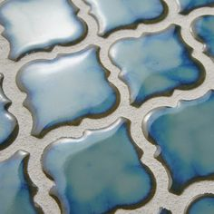 The Pharsalia in marine has a rich, aqua marine color and a classic lantern shape. This tile will coordinate well with other tiles in the Antaeus Series, between their many colors and finishes. These tiles can be used both indoors and out.