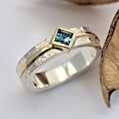 Blue topaz silver and gold ring