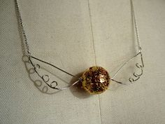 Golden Snitch necklace.  No instructions, but it looks easy enough.