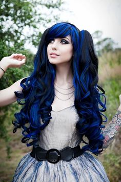 She makes this look amazing! Voluminous black hair with blue streaks