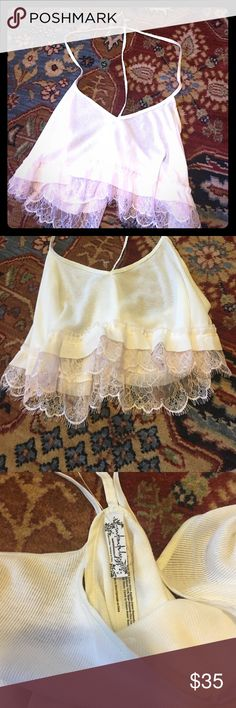 Intimately by Free People top size medium Brand new, gorgeous Intimates by Free People tank top. Size medium, fits true to size. Absolutely gorgeous crop top fit, with intricate lace at the trim. Free People Intimates & Sleepwear
