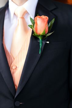 Coral boutonierre for groom and groomsmen