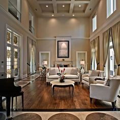 Living room- large windows, large doors, symmetrical lines throughout room make for a more formal feel... Just want to jump in and sit with a cup of tea... ☕