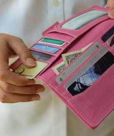 How to De-Clutter Your Wallet|Leave these items out of your wallet to save yourself a major headache if your purse gets lost or stolen.
