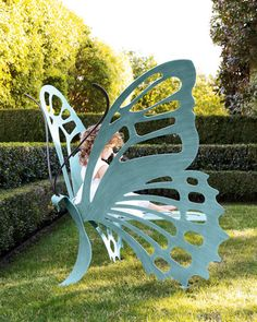 Unique garden bench - you could easily make something like this out of wood and when you sat in it it would look like you had wings. :)