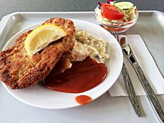 Wiener schnitzel (Austria) Boneless veal coated with a batter of flour, eggs and bread crumbs, deep fried, it is served with mashed potatoes and lemon