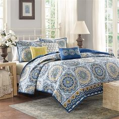 Tangiers instantly adds color and flair to your bedroom. Its bold blue and yellow floral print with large medallions is a modern twist to a classic look. The embroidered detailing on the three decorative pillows pulls the whole look together. This coverlet set also includes two matching standard shams. With a microfiber polyester face and a brushed fabric reverse, this coverlet is soft to the touch and machine washable for easy care.