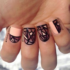 Beautiful black, pink and sheer colored abstract nail art design. The playful lines drawn in bold black polish contrasts with the light pink tips of the nails.