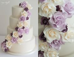 Wedding cake with cascading ivory, lilac and aubergine roses