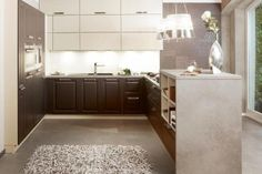 hand painted Dark brown wood shaker kitchen with white wall units built under LED lights