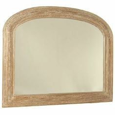 A large, classic style mirror hung above the fireplace will have an instantly uplifting effect. The limed finish keeps it fresh and in keeping with the organic feel of the rest of the room's decor, as it is made from solid mango wood. Large Arched Beaded Overmantle Wooden Mirror - Limed. £255 www.amiska.co.uk