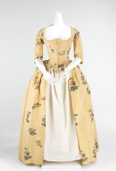 www.metmuseum.org. Dress (Robe à l'Anglaise)  Date: 1776 Culture: British Medium: silk Dimensions: Length at CB: 53 in. (134.6 cm) Credit Line: Brooklyn Museum Costume Collection at The Metropolitan Museum of Art, Gift of the Brooklyn Museum, 2009; H. Randolph Lever Fund, 1973 Accession Number: 2009.300.952
