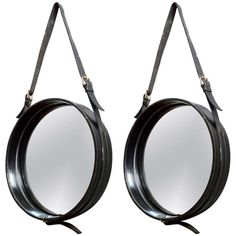 Jacques Adnet pair of smal charming black leather hand stiched mirror | From a unique collection of antique and modern wall mirrors at http://www.1stdibs.com/furniture/mirrors/wall-mirrors/