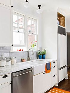 Beveled Beauties  Selecting a simple subway tile with a beveled edge for the backsplash introduces depth and dimension to the space, as the angled edges reflect light. Marble countertops, an apron-front sink, and gray subway tiles with beveled edges, keep this kitchen on the classic side.