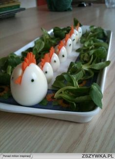 Hard Boiled Egg Chickens Here is another way to present those soon to extra supply of hard boiled eggs! Black peppercorns for the eyes, carved carrot for beak and head.