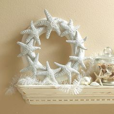 Starfish Wreath. Use a plastic foam wreath and natural starfish available at crafts stores. Spray the wreath and starfish white; let dry. Lay flat, and glue the starfish to the wreath. For added sparkle, brush the starfish with a mixture of half glue and half water, then sprinkle with glitter.