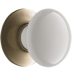 Z017116- Porcelain Knob with Backplate. Comes in different finishes. Nice contrast on the dark cabinetry to tie in the white Marble