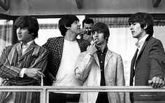 29th July 1964. The Beatles on the balcony of the hotel during the second visit to Stockholm.