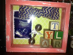 Baby shower gift. Distressed shadow box with vintage block letters spelling baby's name, silver rattle, burlap ribbon bow & sono pic.