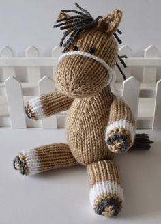 Knitting Pattern for Henry the Horse - Horse toy softie designed by Amanda Berry. Knit flat and assembled. The horse is 23cm tall (when standing from tips of toes to tops of ears).