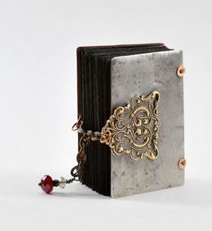 book by Kecia Deveney... Not exactly 'wrought iron' or 'rust' but very pretty little metal book cover...