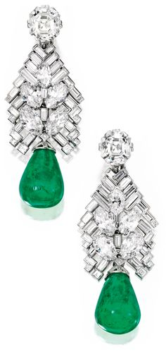 These earrings are topped by one emerald-cut diamond weighing 4.78 carats and one cut-cornered rectangular step-cut diamond weighing 4.77 carats. The diamond surmounts suspend an articulated chevron motif set with numerous baguette, square-cut and marquise-shaped diamonds weighing a total of approximately 11.25 carats. These suspend two emerald drops, together weighing approximately 50.30 carats. 1934