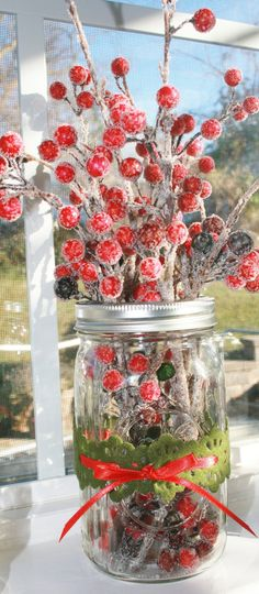 Rustic Christmas Mason jar Decoration    (This would look pretty one on eah end of a shelf, mantle or similar idea)
