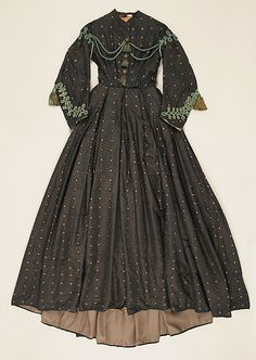 1860s Black silk dress, trim.
