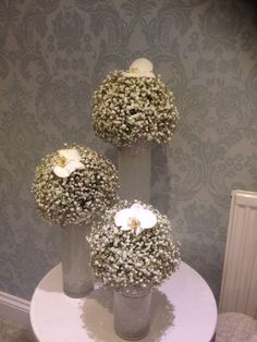 Trio of cylinder vases with diamanté rim ball of excellence gypsophila finished with a phase posits orchid Cylinder Vase, Vases, Elegant Wedding Themes, Gypsophila, Orchids, Bouquet, Color, Beautiful, Home Decor