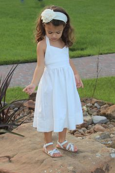 Found the perfect dress for Anna for our family photo shoot at the beach.  White Linen Halter Dress Sizes 6 months to 3 by MonPetitTresors, $45.00
