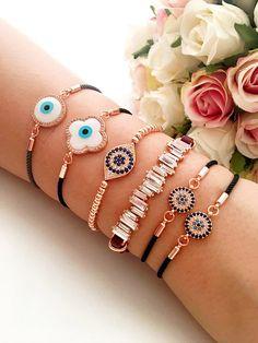 Evil eye bracelets, rose gold eye bracelet, baguette zirconia bracelet, clover evil eye bracelet, adjustable string bracelet, evil eye beaded bracelet There is 5 type of bracelets; 1- Rounded evil eye 2- Clover evil eye 3- Oval beaded evil eye 4- Baguette zirconia 5- black