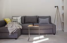 IKEA Friheten Sofa bed in Skiftebo Dark Gray in a Minimalist Loft by AnneLiWest | Berlin25 Quadratmeter Berlin-Mitte