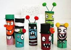 Start with a a variety of cardboard tubes in different sizes. Cut to different sizes and paint in a variety of bright colors. Create fun, simple, whimsical and goofy monster faces. Add details with a sharpie. Use pom poms, toothpicks and more cardboard to create little details for the monsters.