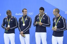 (FromL) France's Mehdy Metella, France's Fabien Gilot, France's Florent Manaudou and France's Jeremy Stravius pose with their silver medals on the podium of the Men's 4x100m Freestyle Relay Final during the swimming event at the Rio 2016 Olympic Games at the Olympic Aquatics Stadium in Rio de Janeiro on August 7, 2016.   / AFP / CHRISTOPHE SIMON